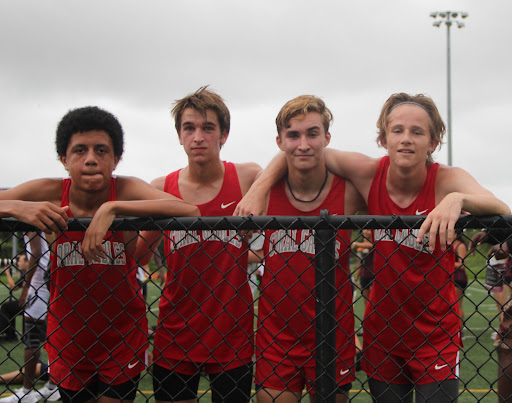 After running 5 kilometers through wet soil, the varsity boys team managed to place first with a 3 minute difference separating them from second place.