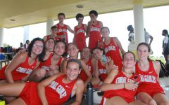 Cavalier varsity girls and boys cross country teams place first team at their meet in Ives Estates Park.