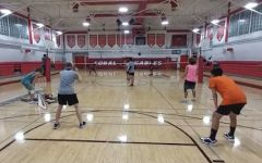 Here the volleyball team can be seen practicing drills in a scrimmage game