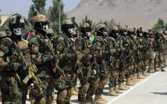 The Afghanistan army lining up, wearing protective masks and carrying guns. Courtesy of The Institute of International Affairs.