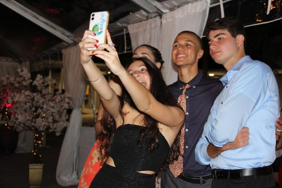 Seniors pose for a selfie, enjoying their last homecoming as Cavaliers.