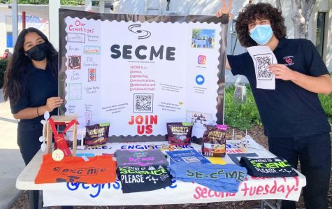 During Gables Club Fair, SECME displayed their past club shirt designs in hopes of attracting possible future members.