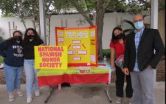 The National Spanish Honors Society board members stand alongside Mr. Sanchez as they work to recruit new students for the club.